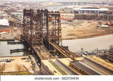 Newark, NJ - April 10, 2019: Gritty view of the Dock Bridge (Amtrak Dock Vertical Lift) over the Passaic River; Red Bull Arena seen in distance.