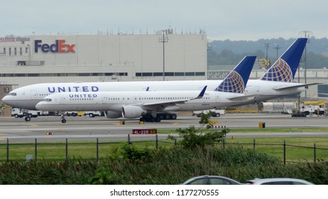 Newark, NJ - August 11th, 2018: A United Airlines Boeing 757 in Front of a United Airlines Boeing 777 Taxiing at Newark Liberty International Airport