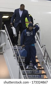 NEWARK, NJ - JANUARY 26, 2014: Seattle Seahawks Marshawn Lynch arrives on Delta flight 8872 charter Boeing 767-300 plane at Newark Liberty International Airport for the NFL Super Bowl XLVIII football