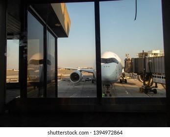 Newark, NJ / USA - 07/02/2018: transatlantic plane at boarding gate in Newark Liberty International airport