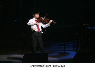 NEWARK - NOVEMBER 9: Violinist Kingston Ho performs at the 9th Annual Concert for Kids on behalf of the Boys and Girls Club at NJPac on November 9, 2011 in Newark, NJ.