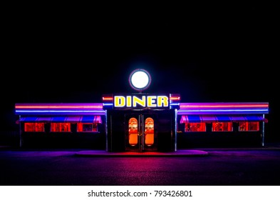 NEWARK, UNITED KINGDOM - NOVEMBER 2, 2017. A traditional American Diner at night with a large sign and clorful luminous, fluourescent and neon lighting that glows in the dark.
