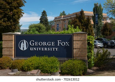 NEWBERG OREGON, AUGUST 15 2017, Close on a sign at an intrance for George Fox University, with a brick building in the background.