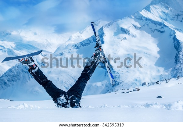 Newbie skier stuck  in deep snow with his legs upside down