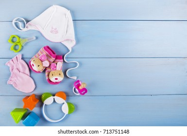 Newborn accessories for a baby girl on a wooden background