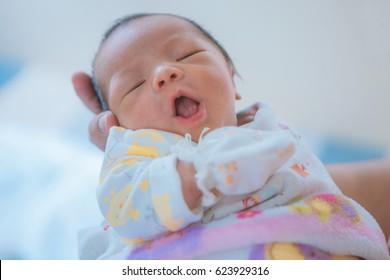 Newborn asian baby asleep