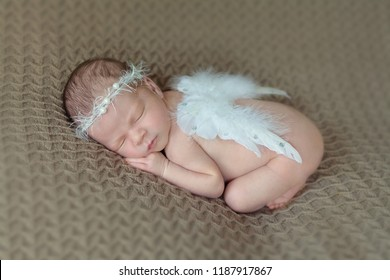 Newborn baby with angel wings