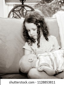 Newborn Baby Being Held by Big Sister Toddler