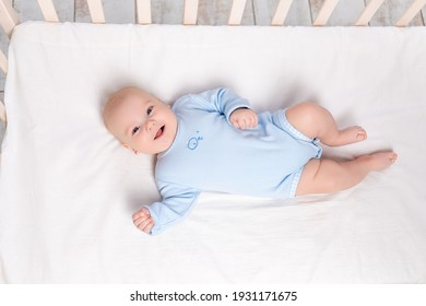 newborn baby boy in the crib, the concept of children and birth
