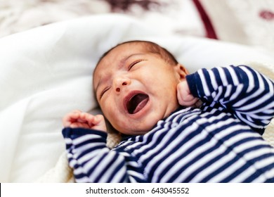 Newborn baby boy crying.