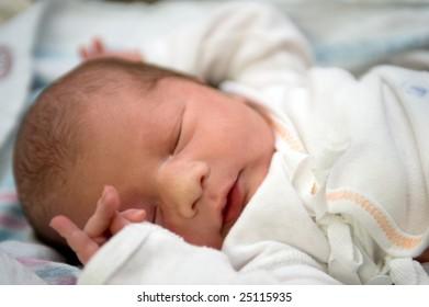 Newborn baby boy at the hospital sleeping