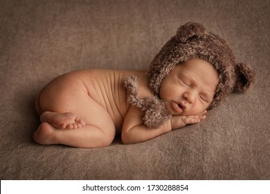 Newborn baby boy. Photo taken with selective focus, noise effect and tinting.