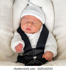 Newborn baby boy sleeping in comfortable car seat. Child safety.