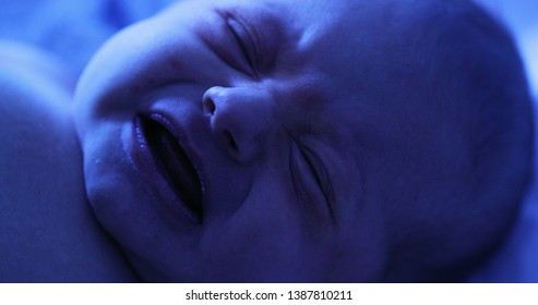Newborn baby boy under phototherapy lamp. getting treated for jaundice