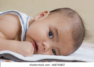 newborn baby concept : close up newborn cute Asian baby boy looking and lying on the stomach, tommy : people and nature concept