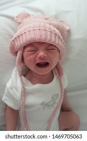 Newborn baby crying at camera