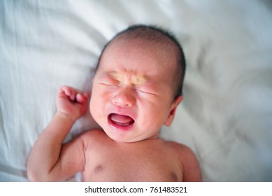 Newborn baby is crying and screaming because hungry.