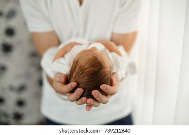 newborn baby with dad in  arms. Newborn  in his father's hands .  men's palm hold a newborn baby Young happy father holding his baby indoor. dad father's day holiday concept