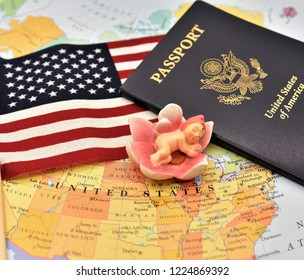 Newborn baby figurine, US Flag and Passport are placed together on the political map of America to depict the Birth right to Citizenship