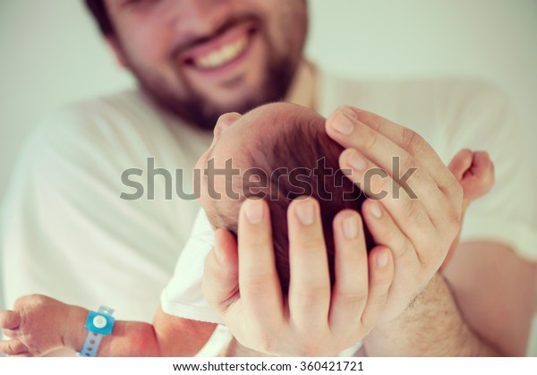 Newborn baby first days with his father