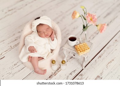 newborn baby girl. A newborn lies in a chair in a bathrobe after spa treatments.