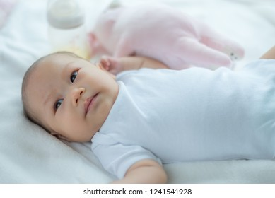Newborn or baby girl on a bed
