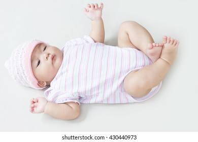 Newborn baby girl in pink knitted hat.
