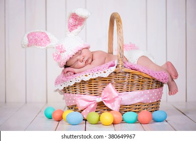 Baby in easter basket images stock photos vectors shutterstock newborn baby girl in a rabbit costume has sweet dreams on the wicker basket easter negle Gallery