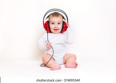 Newborn baby in headphones listening to music