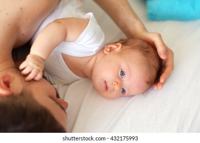 Newborn baby with his father. Shallow depth of field.