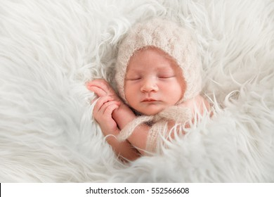 Newborn Baby in knit bonnet