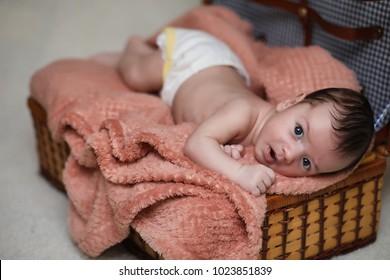 Newborn baby lying on the blanket and sleeping