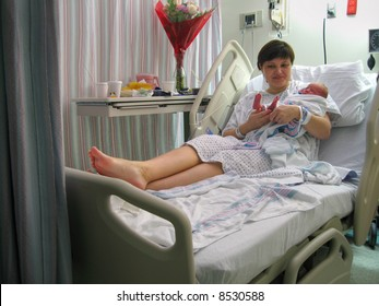 newborn baby with mother in hospital