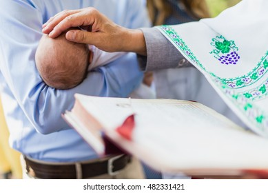Newborn baby on ceremony of child christening in church