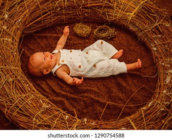 Newborn baby on day care. Happy newborn baby in crib. Safe motherhood service delivery. Motherhood and childhood protection. No one will take care of your children the way a mother would.