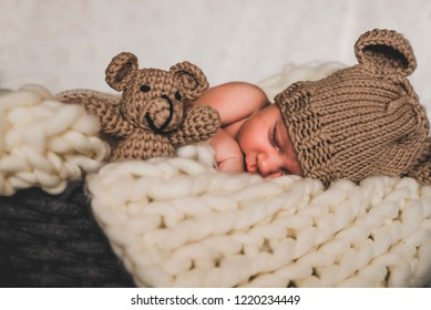 newborn baby photography with small bear toy