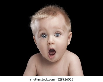 newborn baby portrait with funny shocked face expression
