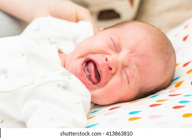Newborn baby screaming in pain with colic