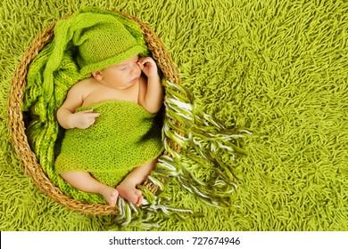 Newborn Baby Sleep, Beautiful Sleeping Infant Kid Boy lying in basket, green clothing