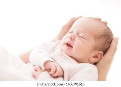 Newborn Baby Sleep on Mother Hands, New Born Girl Smiling and Sleeping, Happy Two Weeks Old Child on White