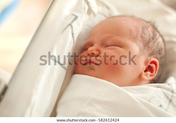 newborn baby sleeping in a maternity hospital