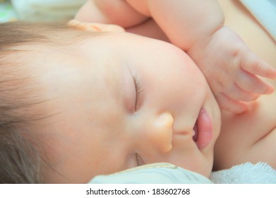 Newborn baby sleeping portrait at night, cute and adorable baby face closeup
