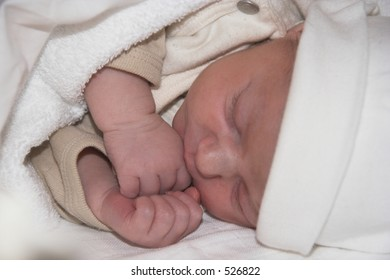 A newborn baby sleeping tight