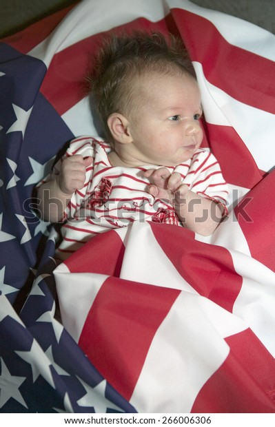 Newborn baby (Sophia Larson) wrapped in American flag was born on October 16th, the birthday of the 300 Millionth American, Ventura, California