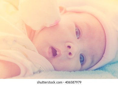 Newborn baby in warm tone, vintage picture style