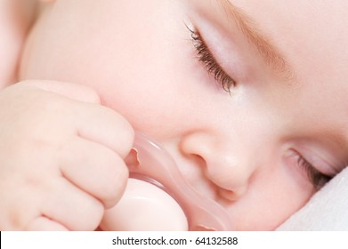 Newborn beautiful baby sleeping. Closeup portrait