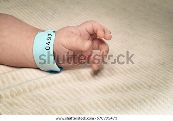 Newborn boy with hospital bracelet