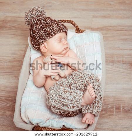 Newborn Boy Pants Hat Asleep Basket Stock Photo (Edit Now) 201629912 ... 1f9dbd905d0
