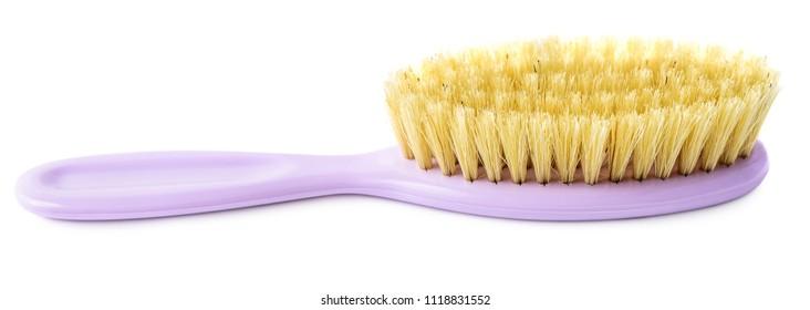 Newborn brush isolated on white background. Kiddie-size hair brush.