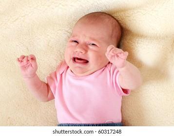 Newborn crying baby.